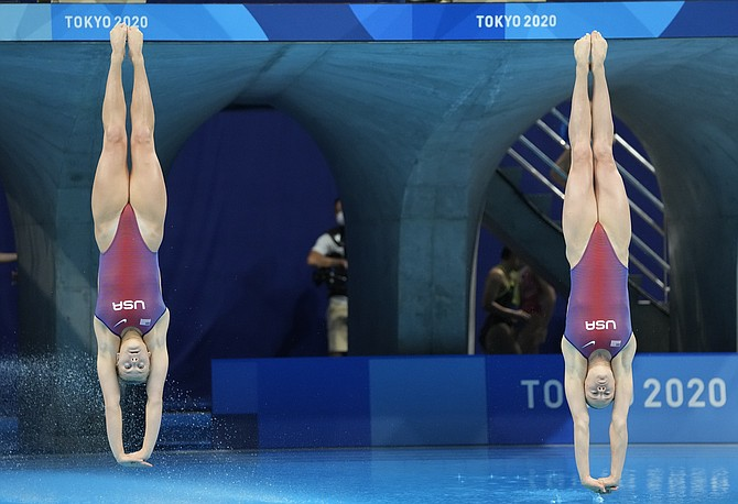 Alison Gibson and Krysta Palmer of the United States' compete during the Women's Synchronized 3m Springboard final at the Tokyo Aquatics Centre at the 2020 Summer Olympics, July 25 in Tokyo, Japan.