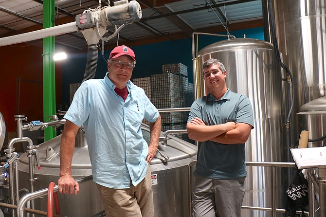Mammoth Brewing Company owner Sean Turner, left, and Lead Dog Brewing Co. owner Ryan Gaumer stand inside Lead Dog's production facility in Sparks on July 14, 2021.
