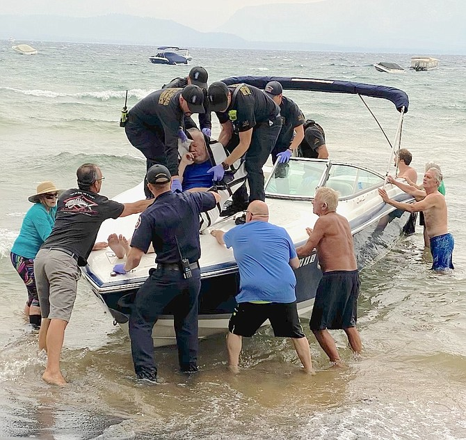 Good Samaritans help a man who suffered from hypothermia after jumping into Lake Tahoe during a storm from a boat that was adrift. Tahoe Douglas Fire Protection District Photo