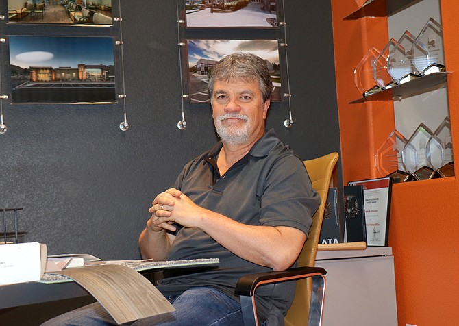 Jeff Frame, owner of Frame Architecture, sits at the front desk of his firm's office in Reno on Monday, July 19, 2021.