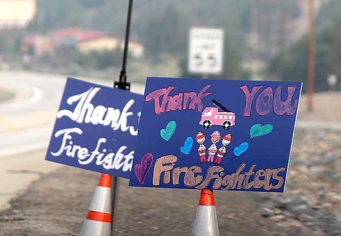 Signs thanking firefighters have sprung up along Highway 395 in the Pine Nuts after the Tamarack Fire.