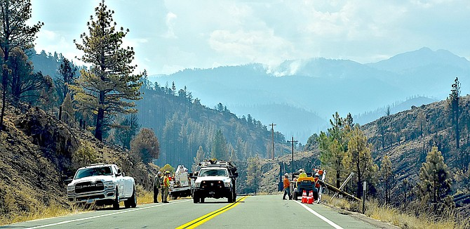 A smoke plume rises in the Sierra above workers in Alpine County on Wednesday in this photo by Gardnerville Ranchos resident Tim Berube.