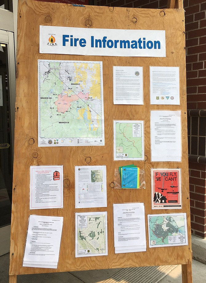 Some old school public information on a board set up at the Gardnerville Raley's dealing with the Tamarack Fire.