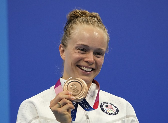 Krysta Palmer of the United States' pose for a photo after winning bronze medal in women's diving 3m springboard final at the Tokyo Aquatics Centre at the 2020 Summer Olympics, Sunday, Aug. 1, 2021, in Tokyo, Japan.