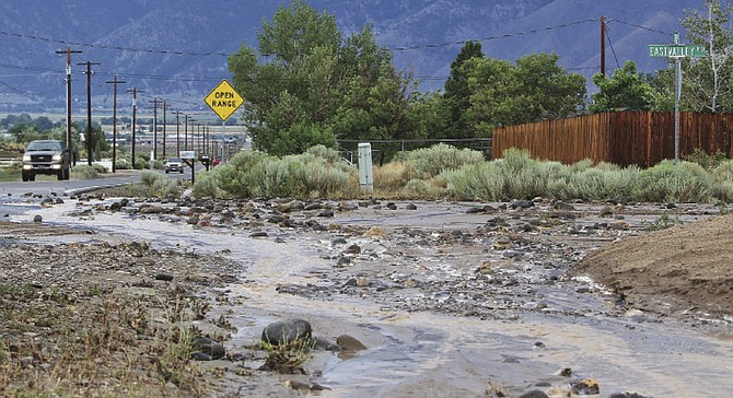 Flooding along Johnson Lane for the second summer in a row in 2015 prompted residents to sue the county in 2016. R-C File photo by Brad Coman