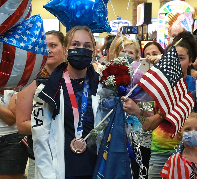 Krysta Palmer looks on at the celebration at Reno-Tahoe Airport upon her return to Northern Nevada.