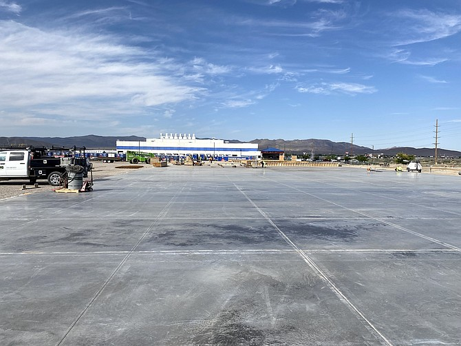 Construction crews work on the 815,000-square-foot building on June 16, 2021.