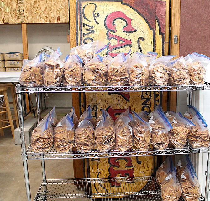 Rows of peanut brittle are bagged at the Genoa Town Hall on Wednesday morning as candy makers work to create more than a ton of confections to sell at next month's Candy Dance.