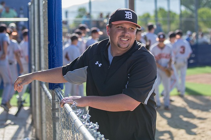 John Glover smiles in his Douglas Tiger gear. Glover, who has worked at Douglas High School for 20 years, took over as the new Tiger athletic director Monday.