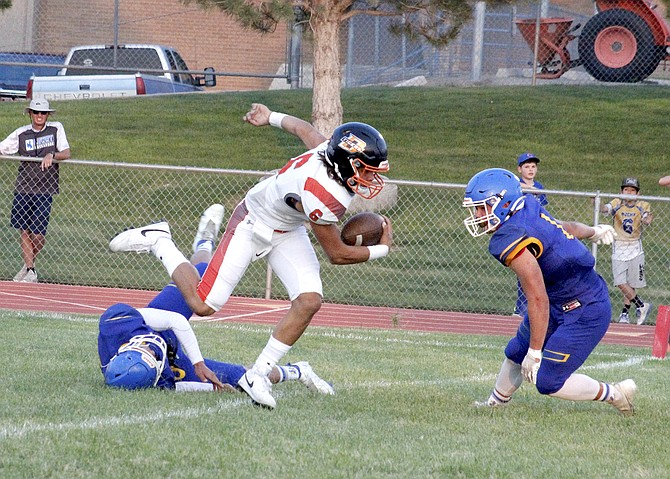 Douglas' Anthony Menzer escapes the tackle of a Lowry defender.