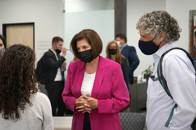 Sen. Catherine Cortez Masto, D-Nev., center, meets with people after speaking at the Reno-Sparks Chamber of Commerce in Reno on Aug. 23, 2021. (AP Photo/Samuel Metz.)