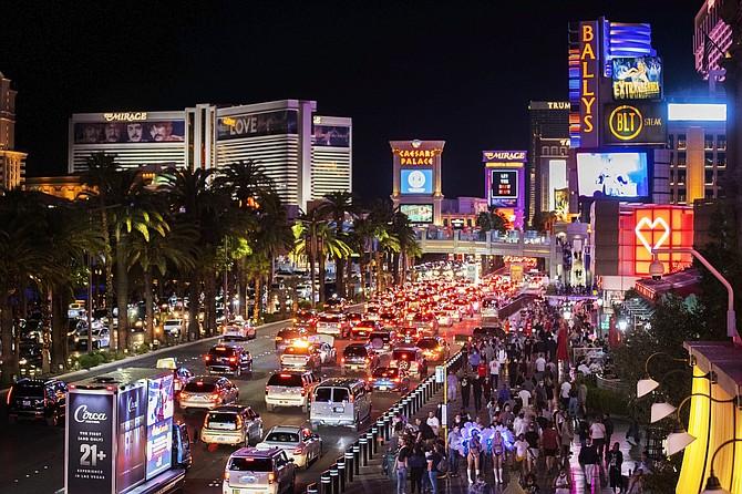 Crowds move along the strip in Las Vegas on March 19, 2021. (Benjamin Hager/Las Vegas Review-Journal via AP, file)