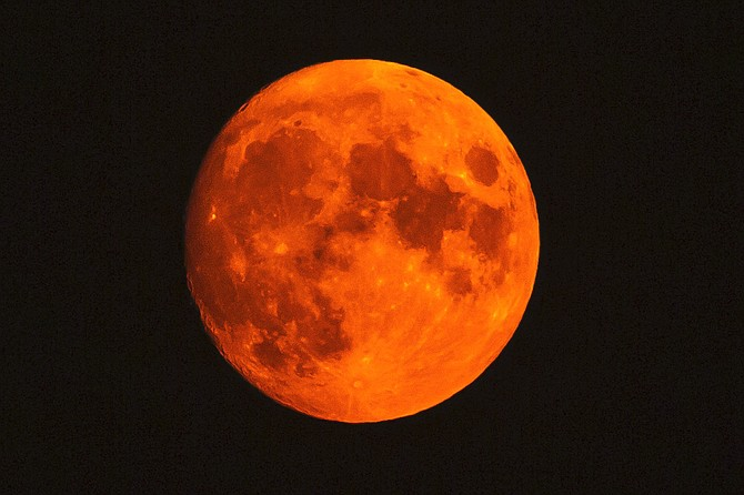 The blue moon turned red from the smoke on Saturday. Jay Aldrich | Special to The R-C