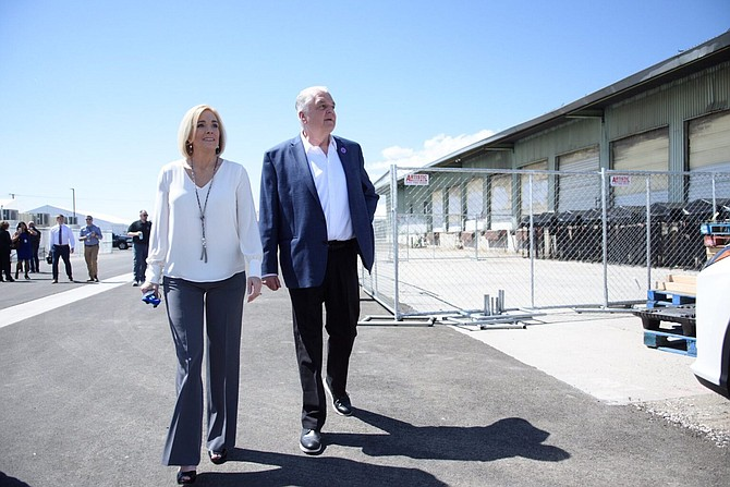 Reno Councilwoman Neoma Jardon walks around the Nevada Cares Campus shelter with Gov. Steve Sisolak in Reno On May 17, 2021.