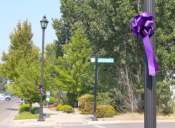 Purple ribbons adorn light poles in Minden and Gardnerville in honor of Suicide Prevention Month