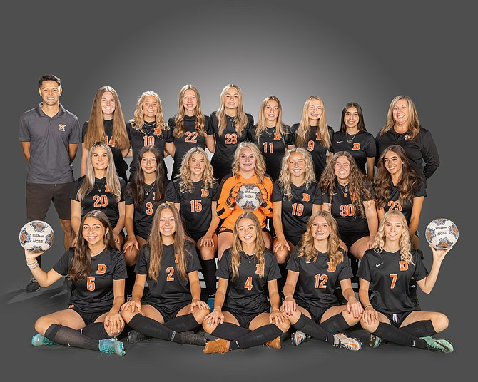 A look at 2021 Douglas High varsity girls' soccer team. Pictured in front, from left to right, are Beatrice Henry-Greard, Sky Rasmussen, Kylee Lash Mackenzie Compton and Seara MacPherson. In the middle, from left, are Aleeah Weaver, Johanna Ruelas, Olivia Rodina, Kylie Martin, Bailey Rozier, Amara Brown and Hannah Schaeffer In the back, from left, head coach Andrew Robles, Zoe Baligad, Shalia Moe, Camden Miller, Ava Coons, Helene Henry-Greard, Campbell Dedmon, Melanie Telles and assistant coach Janelle Martin.