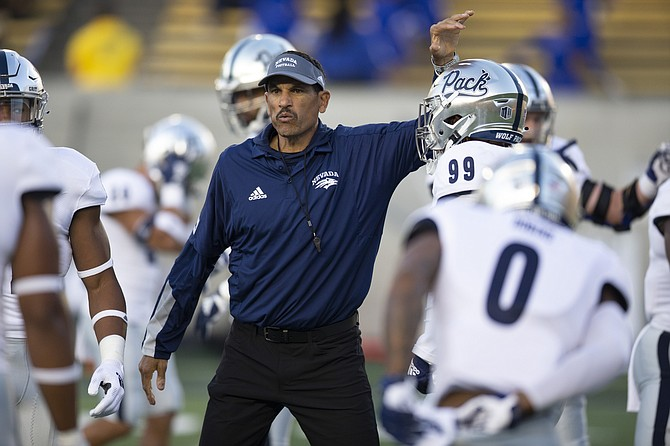 Nevada head coach Jay Norvell fires up his team before the game against California on Sept. 4, 2021, in Berkeley, Calif. (AP Photo/D. Ross Cameron)