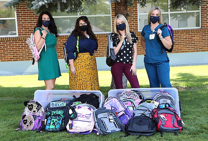 Local organizations, including Carson Tahoe Health, have supplied new backpacks to Carson City School District's McKinney-Vento Students in Transition program. McKinney-Vento special projects coordinator Christie Perkins, second from left, is pictured with Carson-Tahoe representatives Jennifer Brown, far left, Brittney Allen and Makayla Wadsworth.