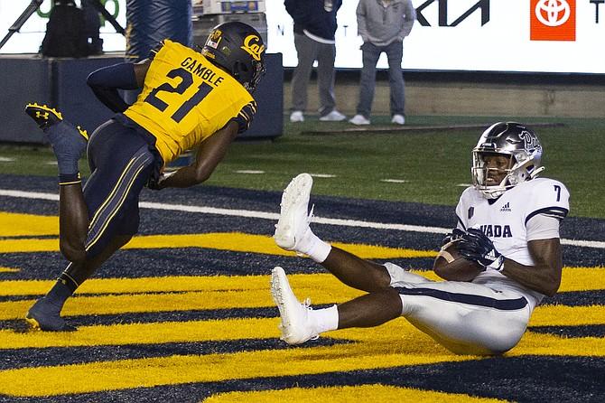 Nevada wide receiver Romeo Doubs makes a touchdown reception behind California cornerback Collin Gamble on Sept. 4, 2021, in Berkeley, Calif. (AP Photo/D. Ross Cameron)