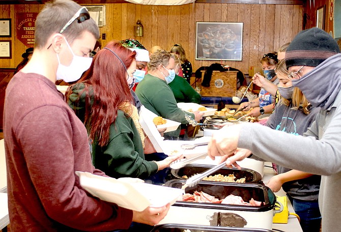 American Legion members and volunteers prepare and package meals for the area's senior citizens on Thanksgiving Day 2020.