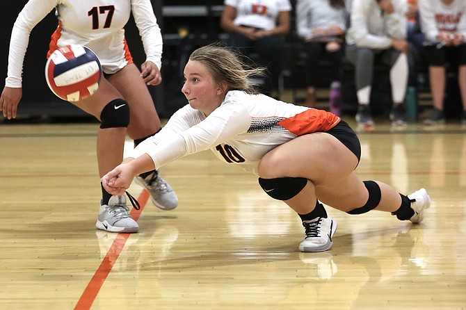 Douglas High's Emma Glover makes a dig against Galena on Tuesday in the Tigers' home gym. The Grizzlies beat Douglas for an early-season win.