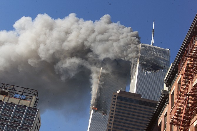Smoke rises from the burning twin towers of the World Trade Center on Sept. 11, 2001 in New York City. (AP Photo/Richard Drew)