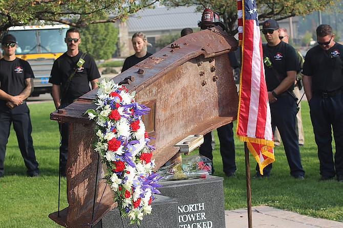 Carson City firemen stand behind a piece of steel from the World Trade Center at the 2020 remembrance. It is now part of 9/11 Memorial at Mills Park. (Photo: Steve Ranson/LVN)