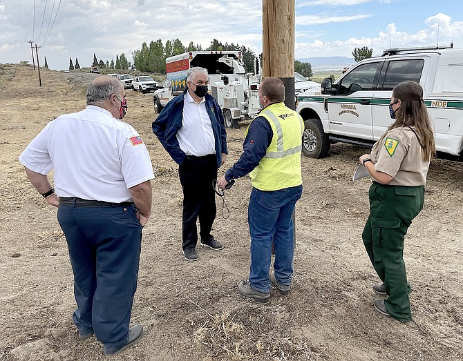 Gov. Steve Sisolak tours power lines along Foothill Road on Friday that were cleared of brush by an East Fork hand crew funded by NV Energy to prevent equipment from causing fires and help stop fires from damaging equipment.