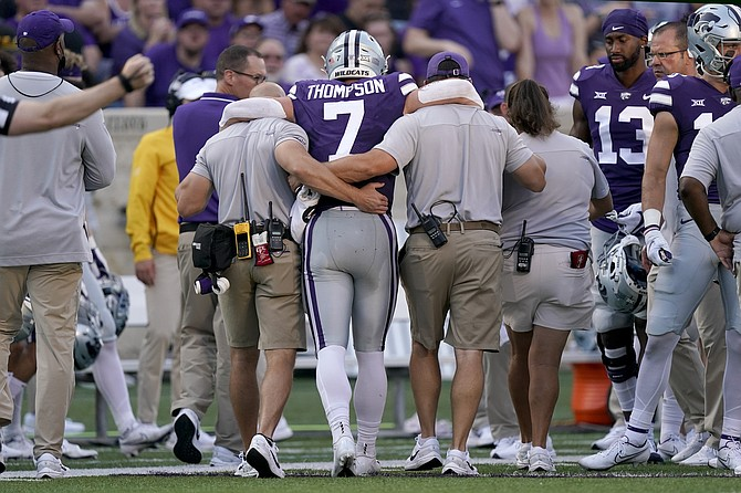 Kansas State quarterback Skylar Thompson is helped off the field after being injured Sept. 11, 2021 against Southern Illinois in Manhattan, Kan. (AP Photo/Charlie Riedel)