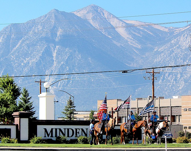 The Douglas County Sheriff's Mounted Posse observes the 20th anniversary of 9-11 in Minden on Saturday.