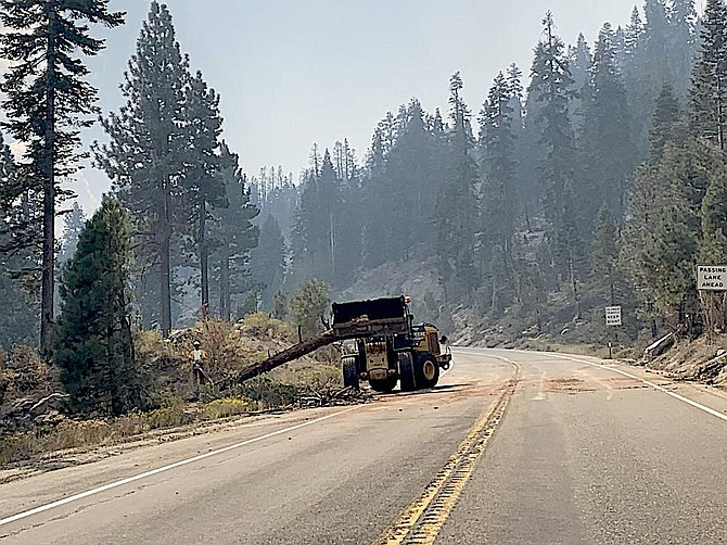 Workers are clearing dead trees from along Sierra highways before they reopen. U.S. Forest Service photo