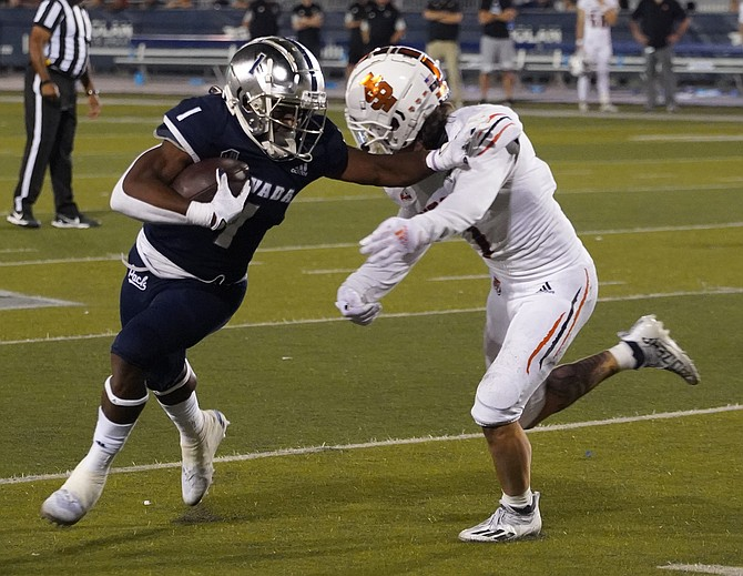 Nevada's Melquan Stovall races around Idaho State's Josh Alford during the game Sept 11, 2021 in Reno. (Photo: Thomas Ranson/NNG)