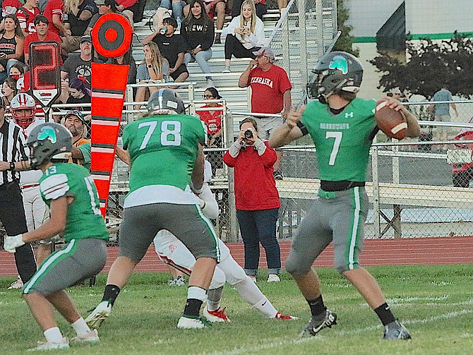 Fallon quarterback Keaton Williams looks for an open receiver.