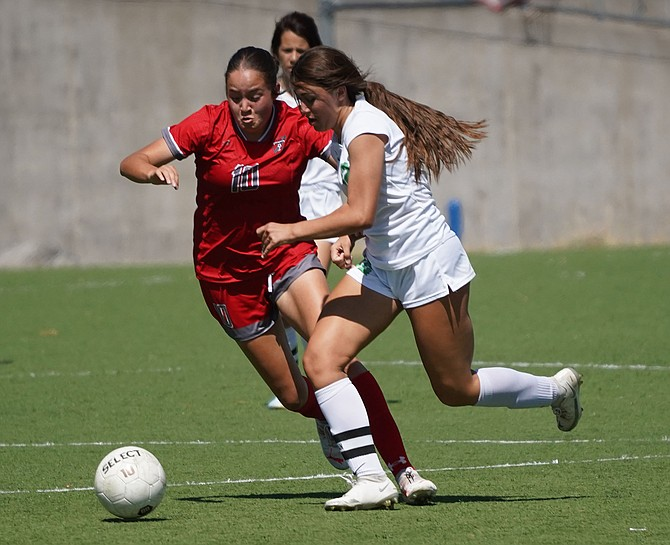 Fallon's Sydney Gusewelle battles for possession against Truckee on Saturday.