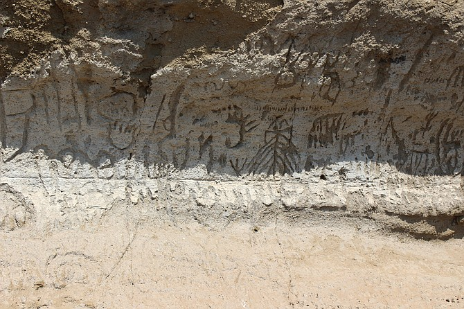 A few of the more than 5,000 petroglyphs found at Petroglyph Point, part of Lava Beds National Monument.