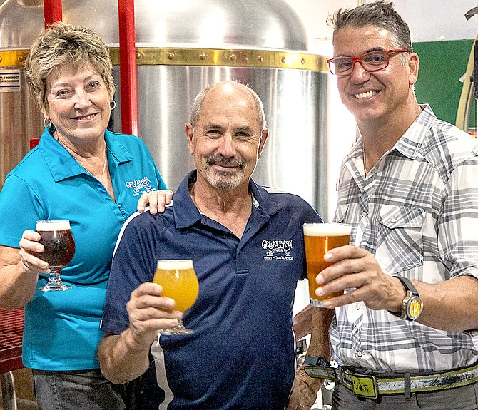 Great Basin Brewing Co. founders, Bonday and Tom Young, toasting Local Food Group Chief Executive Officer Mark Estee. Local Food Group Photo