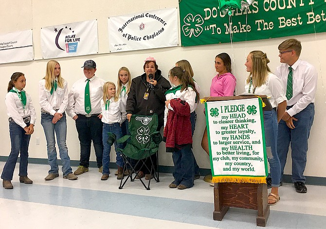 Nita Vick – 32-year 4-H leader of the Carson Valley Shepherds 4-H Sheep club and some of her members and the pledge of 4-H.