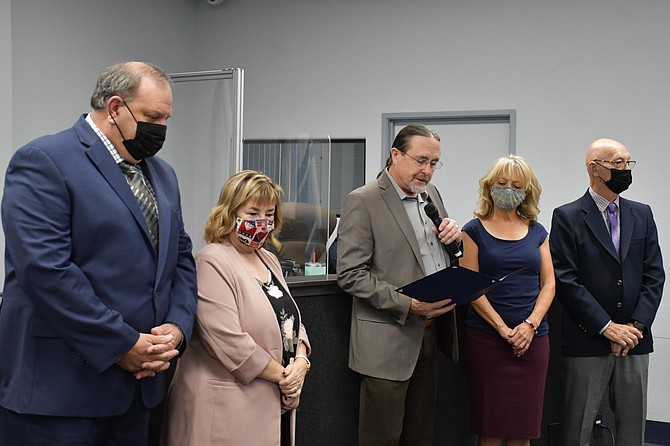 Supervisor Maurice White reads a proclamation by the board Thursday to recognize Constitution Day on Sept. 17.