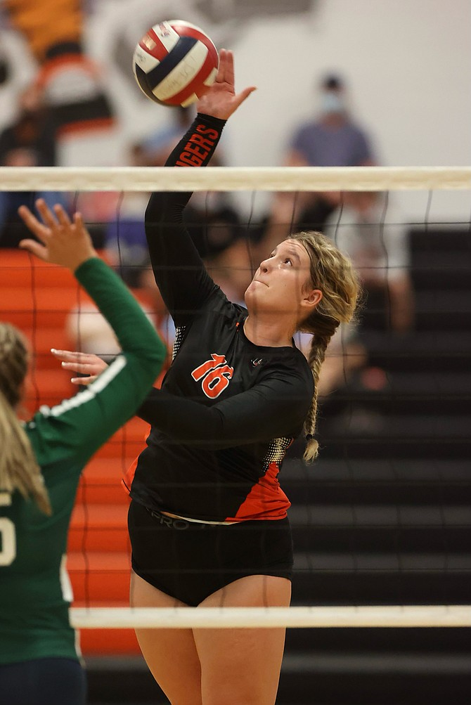 Douglas High's Riley Mello rises up to play a ball against Damonte Ranch on Tuesday. The Tigers swept the Mustangs in straight sets.