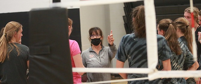 Douglas High volleyball coach Suzi Townsell instructs her team during a practice.