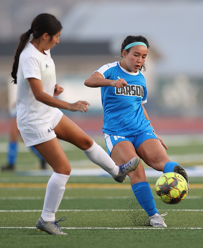 Carson High's Alyssa Tomita shoots the ball during the game between the Reed Raiders and the Carson High Senators.