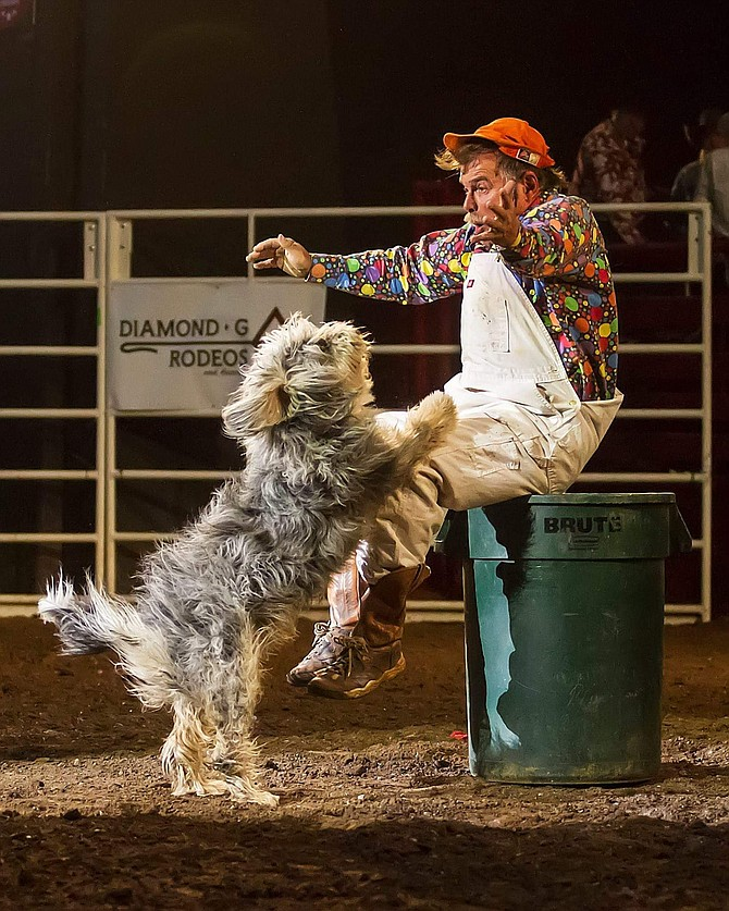 Coppertown Clown Bert Davis performs with one of his dogs. Photo by Andrea Kaus