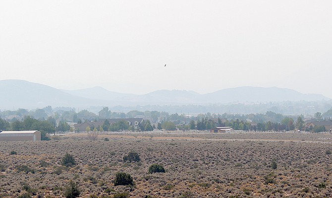 The Pine Nuts are barely visible from Fish Springs Road on Friday afternoon.