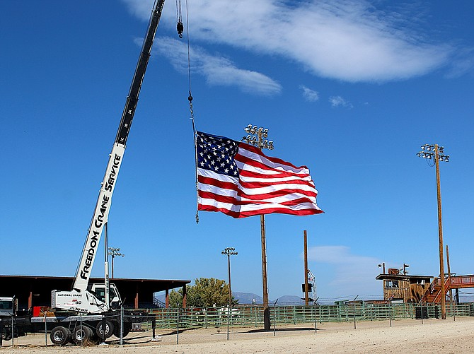 The wind picks up the big flag flying for the Douglas County Rodeo at the Douglas County Fairgrounds on Saturday morning.
