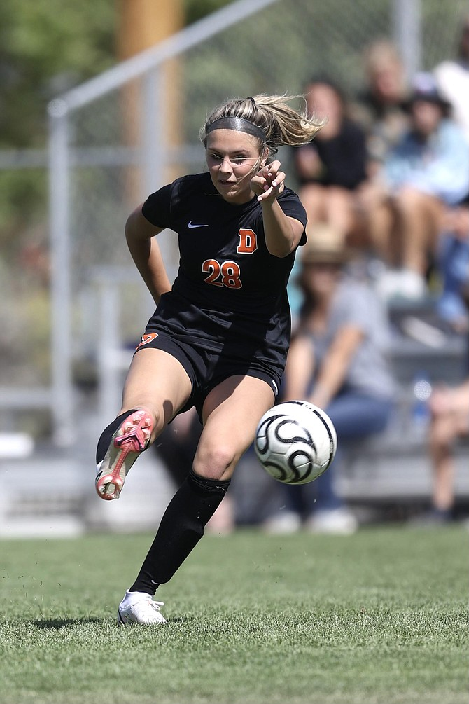 Douglas High's Ava Coons puts a shot on net Saturday. Coons tallied the game winner in the 71st minute to lead the Tigers girls' soccer team past McQueen.