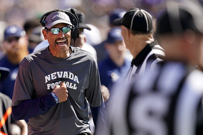 Nevada head coach Jay Norvell talks to officials during the second half against Kansas State on Sept. 18, 2021, in Manhattan, Kan. (AP Photo/Charlie Riedel)