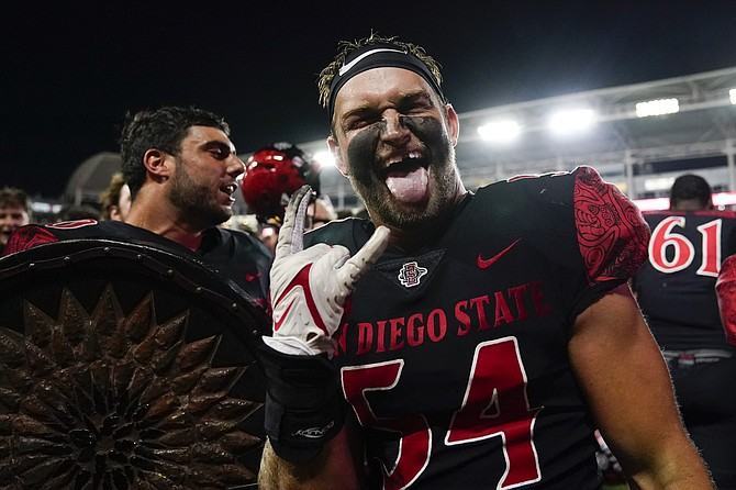 San Diego State linebacker Caden McDonald celebrates after a 33-31 win in triple overtime against Utah on Sept. 18, 2021, in Carson, Calif. (AP Photo/Ashley Landis)