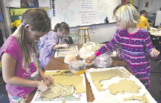 Fourth-graders at Pinon Hills Elementary School work on bowls in this 2017 file photo.