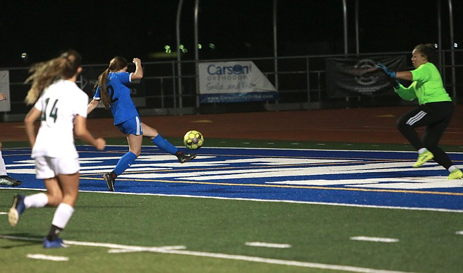 Carson High forward Angie Cortes (12) volleys home her goal in the Senators' 2-0 win over Bishop Manogue Tuesday night.