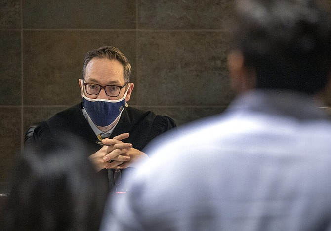 Hearing Master Daniel Westmeyer listens while tenants testify during eviction court at Regional Justice Center in Las Vegas on Thursday, Sept. 2, 2021.